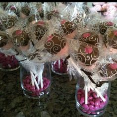 I made these marshmallow pops for a baby shower. I used strawberry marshmallows, chocolate candy melts, and pink m I found the pretty wrappers at Hobby Lobby.