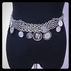 SILVER COIN MULTI CHAIN ADJUSTABLE BELT Excellent condition belt with coins hanging from 4 attached chains that can go up to a 41 inch waist! Accessories Belts