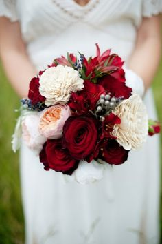 Love!  Maybe a bit less Red for the bridesmaids since we'll have that in their dresses.  But maybe this could be mine?  in a ball?  Winter wedding floral