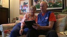 Ray and Ann Goldwire look at some of their family photos in their Gainesville, Fla., apartment, which is part of a university-based retireme... #retirement #money #finance