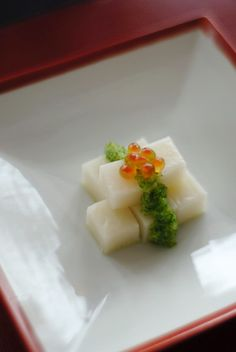 Mochi Rice Cake Topped on Cucumber Sauce and Ikura Salmon Caviar, as Japanese New Year's Dish|お餅のグリーンソースがけ