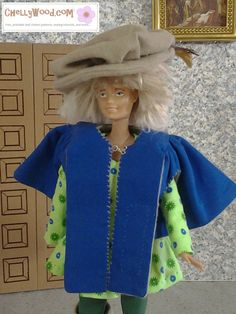 07d2b31615b Doll wig and face up for Barbie who is dressed as a Musketeer. The  Musketeer costume sewing pattern is free to print at ChellyWood.com