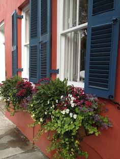 Shutters and window boxes...how romantic and inviting.  Wouldn't go with my Spanish inspired ranch, but I can dream.