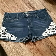 BOHO denim shorts with adorable lace detail Adorable denim shorts with a really pretty crocheted lace detail, frayed bottom and stretchy fabric!  Super flattering and easy to wear.  Size 11 in juniors ... I wear loose but because of the stretch in the fabric it's really forgiving! Shorts Jean Shorts