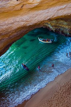 A beach in a cave only reached by sea, Benagil sea cave, Algarve, Portugal.
