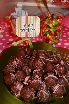 To tie together the entire party decor together I tied pieces of ribbon to everything I could; including serving spoons, tongs, and food labels. I color coordinated the Oreo truffles by streaming them with pink Wilton candy melts.
