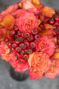 wow those colors are HOT! Roses, callas, rose hips
