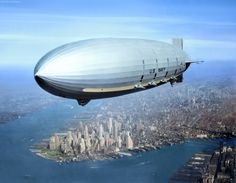 USS Macon Flying over New York Harbor circa Summer 1933. The southern end of Manhattan Island is visible in the lower left center.