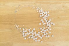 White freshwater pearl necklace with crystal on invisible