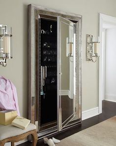 """Glam"" Floor Mirror - Neiman Marcus. Patterned, beveled-mirror glass highlights this glamorous floor mirror. But there's more to this mirror than meets the eye. A hidden compartment behind the center mirror allows for pocket storage of valuables. Imported.•Handcrafted of hardwood solids, laminated lumber, resin, and plated mirror glass.  •Hand finished in antiqued silver.  •One hidden door.  •48""W x 4.25""D x 82""T.  $1659"