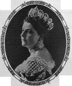 A large diamond tiara, worn by the Viscountess of Galway. Deigned as a central arthemion flanked by five scrolling foliate diamond mofits on either side.