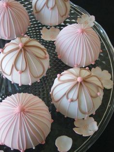 Dessert Table Cupcakes.  . Fantastic piping skills,, pink and white and a soft brown .