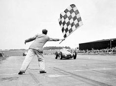 1950 – The first round of the Formula One World Championship is held at Silverstone, United Kingdom. The race was won by Italian Giuseppe Farina in his Alfa Romeo, barely defeating his Argentine teammate Juan Manuel Fangio. Alfa Romeo, Formula 1, Italian Army, British Grand Prix, Checkered Flag, Car And Driver, Number Two, Vintage Racing, Places