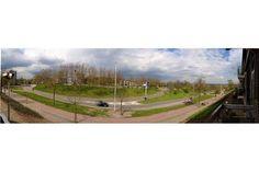 Uitzicht over het Keizer Traianusplein vanaf het appartement aan de Graadt van Roggenstraat 29
