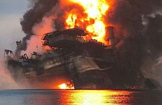 Semi-submersible oil drill, Deepwater Horizon, exploding and burning before sinking into the ocean.