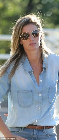 Jean-ie: The stunning supermodel stepped out in a denim button-down shirt and denim shorts