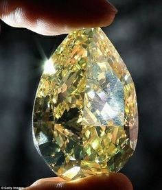 Close-up of the World's largest yellow pear shaped diamond, 110cts