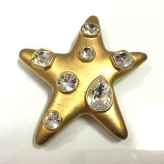 Vtg Signed KJL Kenneth Lane Iconic Jackie O Rhinestone Star Brooch Book Piece Available for purchase at Dellagraces Vintage Jewelry  LL38o #KennethJayLane