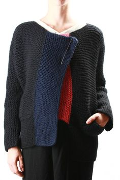 For inspiration: Daniela Gregis - hand knit garter stitch chunky jacket in black with navy, bands at open front, wide shape, boat neck, safety pin closure, slit pockets, one with red inside, long kimono sleeves, high hem band.