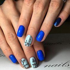 Geometrical Blue Nail Art Design. check out this adorable blue nail art design patterned up with the geometrical design.