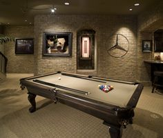 If you have the room, a pool table such as this, with the taupe felt, is a must when it comes to the remodeled man cave. We never would have thought of adding a Mercedes Benz logo on the wall. Nice touch.