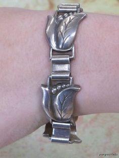 Vintage Georg Jensen sterling silver floral themed bracelet. #silver