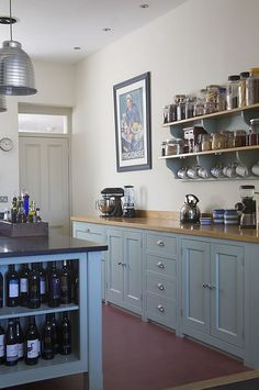 I love the shelves for all of the jars of good. And I've always wanted to hang the mugs under a shelf/cabinet like that.  Super cute.