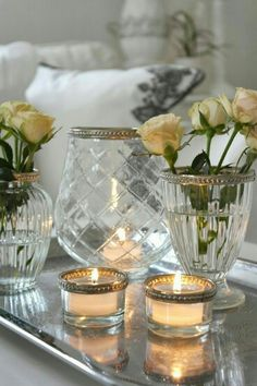 White candles, crystal vases and mirrors are always classy. These votives have some bling along the rim which you could dress up ordinary glass votives with decorative ribbons as long as they don't make contact with flames.