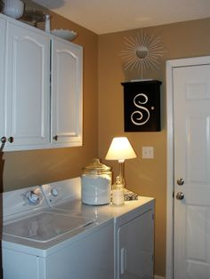 Lovely Laundry Room - but, wouldn't that lamp/jar of laundry detergent and candle rattle right off of there with 1 load of laundry?!?
