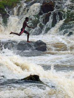 Boy jumping the Lobo Falls, Kribi, Cameroon.  Photo: ToSStudio