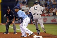 GAME 3: Sunday, April 8, 2012 - Tampa Bay Rays first baseman Carlos Pena, left, gets the out at first base on New York Yankees' Derek Jeter following Jeter's grounder to second base during the first inning of a baseball game in St. Petersburg, Fla. The Rays won 3-0. (AP Photo/Brian Blanco)    Read more: http://sportsillustrated.cnn.com/baseball/mlb/gameflash/2012/04/08/40533_gamephotos.html#ixzz1rWrhaRkv