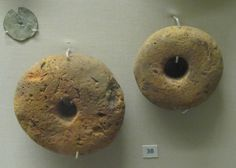 Loom Weights--the only way to tell the existence of a warp-weighted loom, since they often remained after the rest of the loom and house had burned--from British Museum.