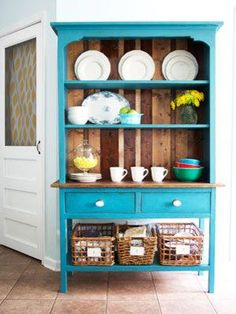 """It's not just about colors in 2013. """"Earthy textures lay a new foundation for palettes of blues and greens,Breathing new life into an existing hutch with several coats of ocean-blue paint, Ground the oversize piece with lots of white ceramic objects and natural wood and wicker."""