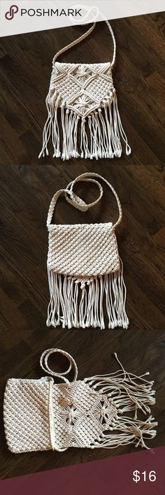 Vintage looking Macrame' fringe bag Awesome Macramé rope fringe bag. I actually thought this was vintage but it's mossimo!? Crazy! It's in terrific condition, and perfect with a swimsuit or maxi. It's off white and can be long or shorter if you just knot the top. It's medium in size and super cute. Can be worn with anything! Mossimo Supply Co Bags Crossbody Bags