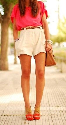 love the highwaisted short paired with the loose pink blouse. bag and belt complete the look