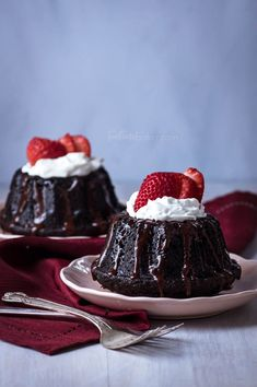 Whether you love or hate Valentine's Day you'll want to try these Dark Chocolate Mini Cakes with Espresso Ganache! Dark chocolate cake is drizzled with decadent espresso ganache and topped with whipped cream and a sliced strawberry. Perfect for celebrating any occasion. | Valentine's Day Dessert | The Teatime Baker | Mini Bundt Cakes | #chocolatedessert #espressoganache