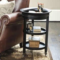 """Ethan Tray Table. $149. Top tray lifts off. 26.5""""H x 18"""" diam. 7.5"""" between shelves. Rubbed Black, old world brown, or ivory."""
