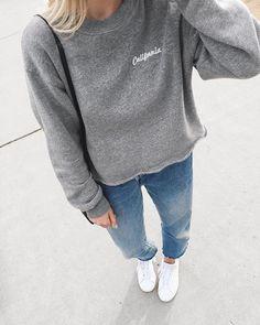 Mija Mija wearing Brandy Melville California sweatshirt, levis jeans, adidas originals