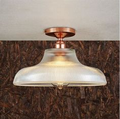 With a simple design, the Mono Industrial Railway Flush Fitting will add a timeless feel to any interior. This holophane ceiling light is a functional design for cloakrooms, bathrooms and utility spaces. Designed to maximize illumination even in small areas, this flush ceiling light increases light levels in the space and reduces the contrast between task and general lighting