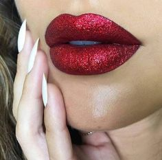 Love this red glitter lip for the holidays! How to: Dab your finger into any glitter and then pat onto your lips right after you've applied your favorite red liquid lipstick. The glitter will set while your lipstick is drying.
