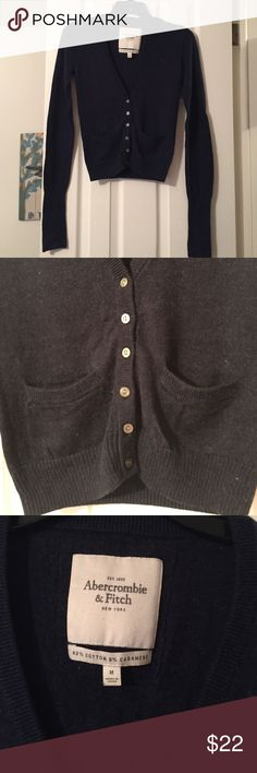 "A&F navy cropped cardigan A&F navy cropped v-neck cardigan. 2 front pockets. navy moose emblem embroidered on left front chest. cotton/cashmere blend 20"" length. Sleeves are long with an extra long cuff shown in pic 4 any questions just ask. hand wash cold. no noticeable piling Abercrombie & Fitch Sweaters Cardigans"