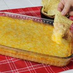 Texas Trash Dip: The ultimate ooey, gooey, cheesy bean dip recipe. Serve as a quick and easy appetizer for your game day party.