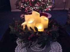 Luminara candles with a Christmas wreath