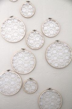 Embroidery Hoop Lace Wall Art - add pastel color fabrics behind the lace - perfect for repurposing a wedding dress