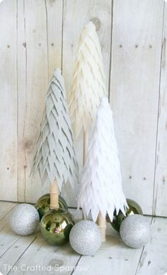 Felt Christmas Trees DIY Christmas Decorations ~ Create a simple yet stunning holiday centerpiece with these trees made from a cone and inexpensive felt.