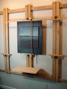 DIY Wall-Mounted Easel - excellent design and tutorial with pictures. I'm planning to build one of these. Especially good for cement studio walls that can't be arbitrarily nailed/screwed into. Great space saver and great for vertical painting, which I pre Art Studio Storage, Art Studio Organization, Art Storage, Wood Storage, Art Studio Design, Art Studio At Home, Home Art, Painting Studio, Artist Painting