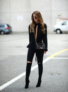 justthedesign: Anette Haga is looking fierce in this all black outfit of black jeans and an open-slit tee! Top: H&M, Bag: Chanel, Jeans: Topshop, Shoes: Christian Louboutin