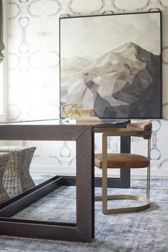Home office + vintage rug + textured wallpaper + neutral wallpaper + modern seating + large landscape art + abstract art + low back desk chair Blue Subway Tile, Blue And White Pillows, Glass Top Desk, Mirrored Coffee Tables, Wood Mantels, Dining Chair Slipcovers, Pedestal Dining Table, Side Chairs, House Design