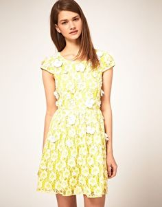 all-over lace, a contrast floral applique detail, whimsy & bright. great for a bridal shower, casual rehearsal dinner or summer bridesmaid. asos, $214