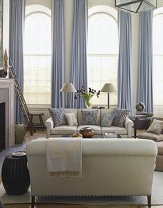 A Soothing Living Room Grandly arched windows in the 18-foot-high living room, designed by Christopher Maya, are framed by the icy blue of Holland & Sherry Glace curtains in Glacier. Description from pinterest.com. I searched for this on bing.com/images